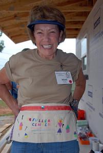 """Mimi Crowley of Tucson, AZ putting on her """"designer"""" nail apron. mlj"""