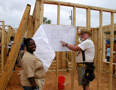 Shakeil McCants is happy to help Jack Evans hold her house plans. Lise Green
