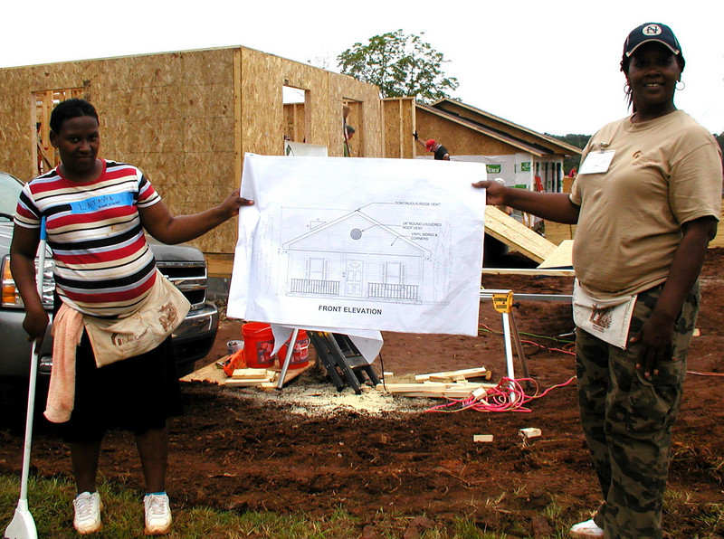 Homeowners Latasha Billingslea and Lisa Trammel with blueprints. Lise Green