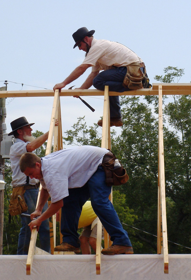 Amish volunteers from Pensylvania stabilize trusses. kl-b