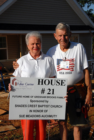 Jim & Sue Auchmuty at site of home sponsored and built with volunteers from Shades Crest Baotist Church of Birmingham, AL.. crl