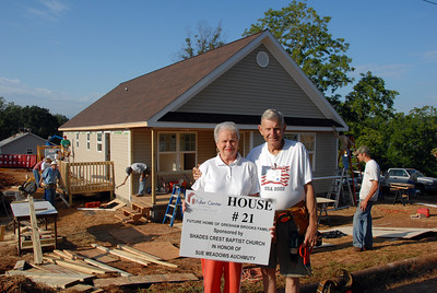 Jim & Sue Auchmuty in front of House # 21. crl