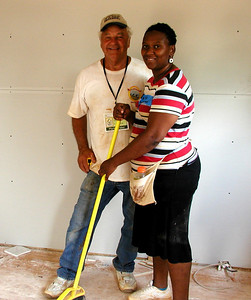 Merle Graber and Latashia Billingshlea in the kitchen. Latashia says her favorite thing to do is sweeping. Lise Green