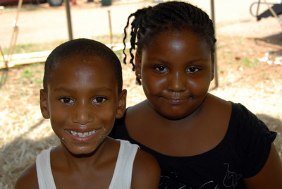Happy children awaiting the move into their new home. crl