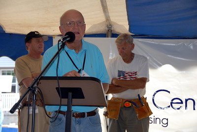 Bill Scott, Pres. of Chattahoochee Fuller Center Project - Overall Coordinator, speaking. David Snell, President of Fuller Center for Housing International and Rev. Jim Auchmuty in back. crl