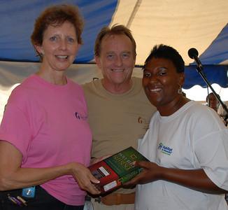 Latasha Billingslea receives Bible presented by Linda Fuller and David Snell. crl