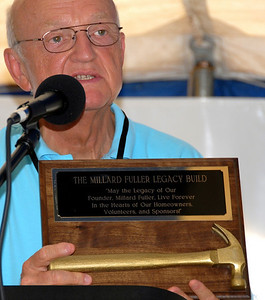 "Words on plaque - ""May the Legacy of Our Founder, Millard Fuller, Live Forever In the Hearts of Our Homeowners, Volunteers and Sponsors."" crl"