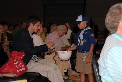 Scouts pass hard hats for offering. More than $4,000 rendered by Celebration attendees. crl