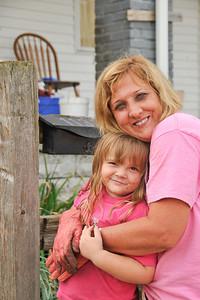 10 09-08 Molly's granddaughter Mandy getting a hug from Kim Roberts.  mlj