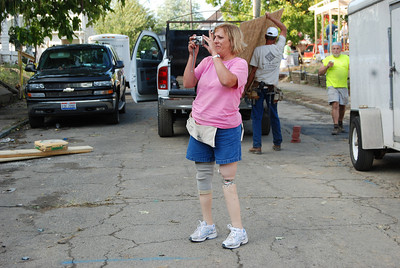 10 09-08  Kim Roberts of Lanett, AL taking a break to capture a photo of Molly's greater blessing project.  cl