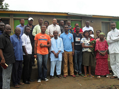 10 09-10  President Fuller Center Nigeria Sam Odia (top center) with homeowners.  so