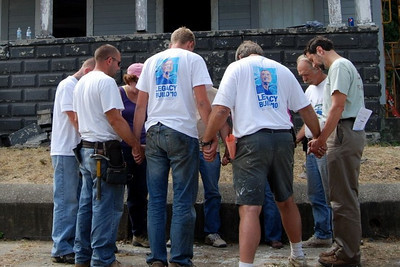 10 09-10 Crew praying together before starting last day of work. mlj