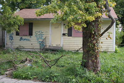 09 10-27  Boarded up; unoccupied. Houses like this will be restored and make a family a nice place to live. bb