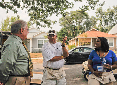 10 09-09  PNC Bank officials visit several Greater Blessing houses. They are very impressed with how their $25,000 made such a huge difference for 14 homeowners.  mlj