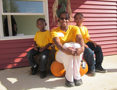 Shanika Harris with her sons Aaron and Andrew on the front porch of her new home.