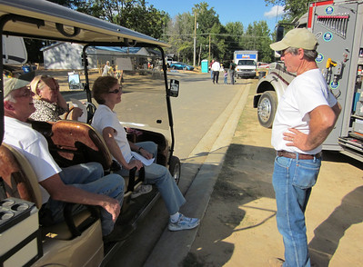 From left, Paul Degelmann, Brenda Barton and Linda Fuller Degelmann talk with construction supervisor Bill Moriarty after homes were dedicated.