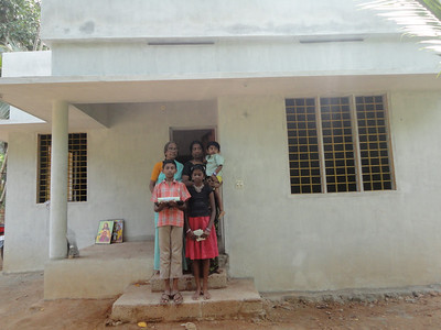 The Soosan Rajam family moves into their new home (India).