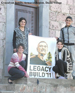 Gyozalyan family on the front steps of their new home.