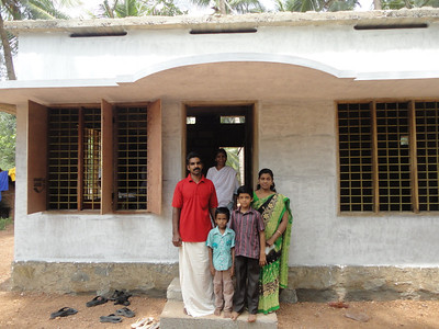 The Saji family moves into their new home (India).