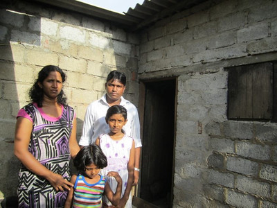 The Richard family fell on hard times when the father of the family, L.G., wasn't able to make ends meet with his job as a private security guard. The family has been living with L.G.'s parents for several years in Willorawatte, Moratuwa, Sri Lanka. The one-room home has no doors or windows and very limited space for its six inhabitants. They've had plans to build a room adjoined to his parents' home but have never been able to execute these due to limited funds and resources. After many years of waiting and saving, they reached out to The Fuller Center for Housing of Sri Lanka, which approved the family's application.