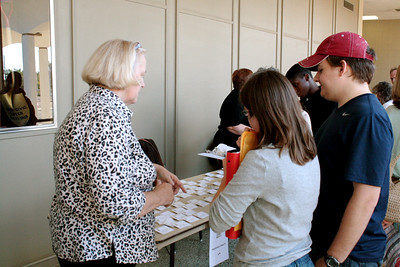 2011 10-15  Brenda Barton helps people register upon arrival.