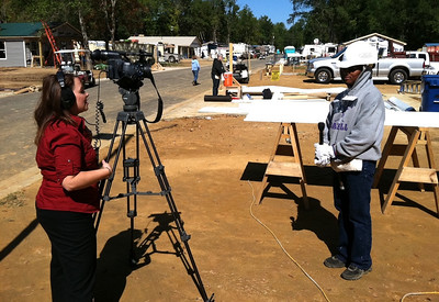 Brittany Bivins of Shreveport's Fox 33 interviews soon-to-be Fuller Center homeowner Shanika Harris.