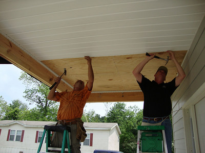 10 05-01 PJ Riner and David Danel cover the front porch ceiling. td 2010 08-06  Mama Black moves in immediately folliwng dedication.   ksf
