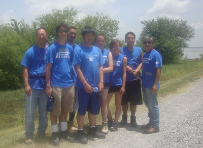 2010 07-16  San Francisco volunteers pose on the Mississippi River levee near Mama Black's house. td 2010 08-06  Mama Black moves in immediately folliwng dedication.   ksf