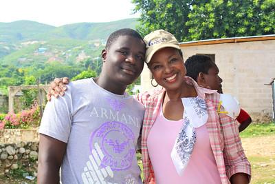 Team member Gloria Peaden with a new Haitian friend.