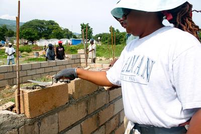 Nikita Patterson lays bricks.
