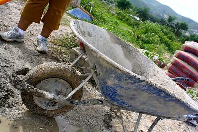 A very dirty, well-used wheelbarrow.