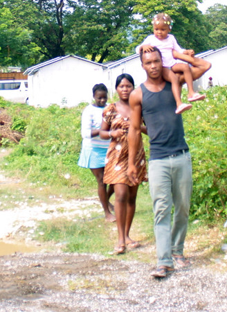 A family cuts through the work site.