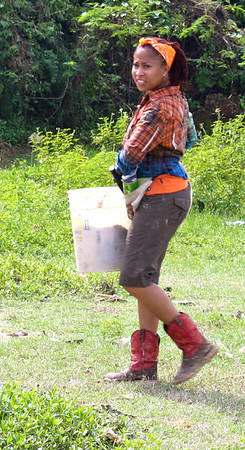 Kimberly Lacy transporting building materials.