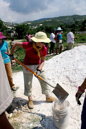 Team member Renee Concilla works on mixing concrete.