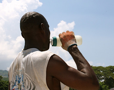 A member of the Haitian labor force takes a water break.