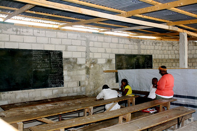 A few students sit in a classroom in Grace International's refugee camp. (Class was not in session).