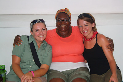 Team member Donna Fitzgerald (center) hugs team members and sisters Meghan and Katie Bool.