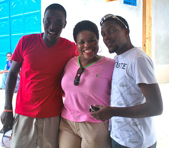 Beverly Black with two of the group's Haitian friends, Jenel Moise and Djimy Francois.