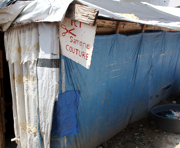 Haitians in the refugee camp start their own businesses, like this barber shop.