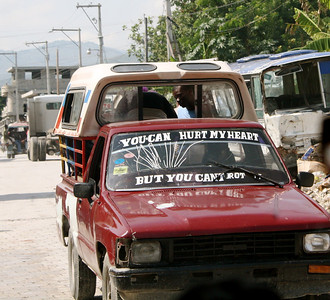 One of the many interesting signs on cars, buses and buildings in Haiti.