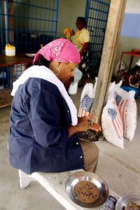 Team member Carol Truesdale sorts through beans for a meal that will feed almost 500 hungry Haitian children.