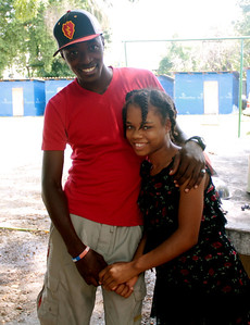 Jenel Moise was raised in Grace International's orphanage, and now works their as an English teacher there. Here he's pictured with one of the orphans.