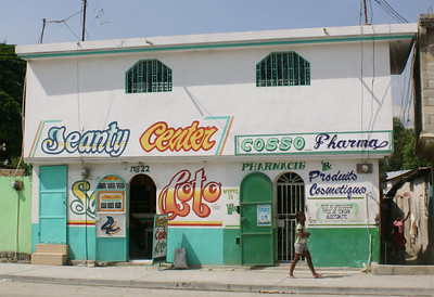 An example of the colorful signs painted on buildings in Haiti.
