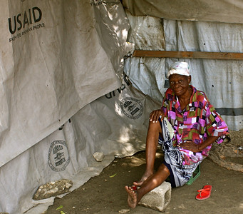A woman sits in her tent in Grace International's refugee camp.