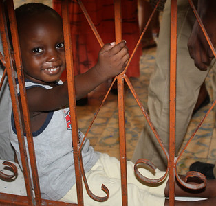 Caleb, who lives at the Grace International Boy's Home (orphanage), offers a sweet smile to the team as they tour the building.