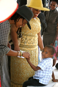 Team member Janet Lee greets a Haitian boy in church.