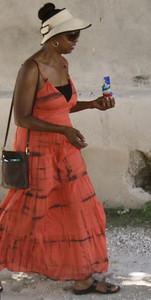 Team member Gloria Peaden walking outside of Grace International in her church dress.