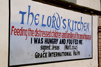 A sign for The Lord's Kitchen, a program in which the team participated –they purchased and distributed rice and beans to 486 hungry children in Grace International's refugee camp.