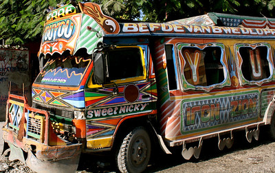 One example of the colorful signage and decoration that adorns Haitian vehicles, buildings, and walls.