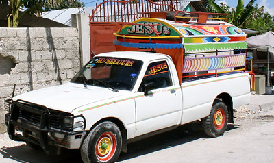 One example of the colorful signage that adorns Haitian vehicles, buildings, and walls.